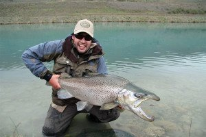 Charles Smith from The Complete Angler, in Christchurch, with a horse of a brown trout. Congratulations Charles!