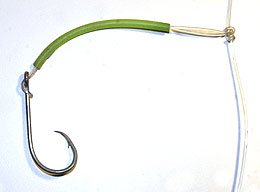 Note the line is exciting from the correct side of the hook eye of this deep water groper rig complete with fluorescent tune over the dropper. This is a typical recreational use of Mustad E-Z Baiter hooks.