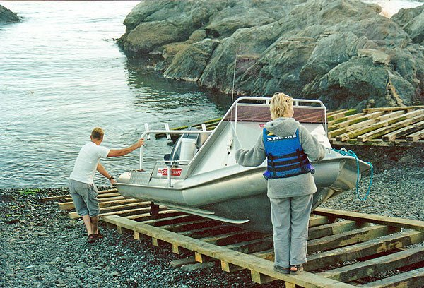 The long wooded Goose Bay boat ramp in action. Boats must be pulled to the top with a rope fastened to your vehicle.