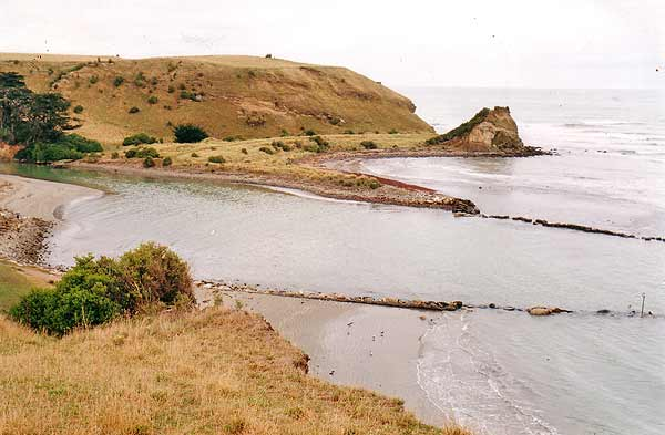 This view of the entrance to the Motunau River has been taken from the hill above it looking northwards. You can see in this picture just how precarious a boat passage it is. Every so often it has to be dredged to keep it open.
