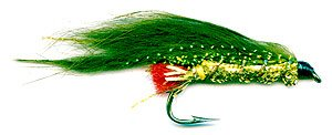 The Olive and Gold Zonker is an ideal lure for fishing a South Island West Coast lake or river. Here the lure is tied on a size 6 hook. Note that if the lure is to be used for fly casting a slightly shorter tail will prevent it from wrapping around the hook shank when casting.