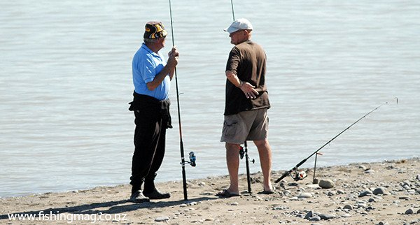 Anglers fishing at the mouth of the Wairau River Diversion.