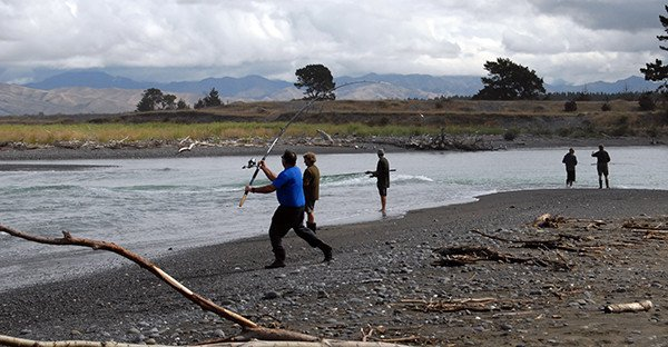Spinning for kahawai at the mouth of the Wairau River Diversion.