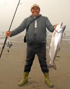 Lilik with 3rd salmon this season - Waimakariri River Mouth March 2015.