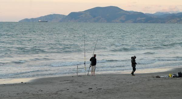 Surfcasters fishing the Front Beach on Rabbit Island.