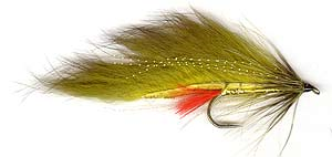 Olive/Gold Rabbit Trout Lure. The wing is olive dyed rabbit strip. The body is flat gold tinsel with the rabbit strip secured to the body with gold oval tinsel.