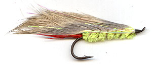 Yellow Rabbit trout lure tied on large size 1 Tiemco TMC 7999 salmon hook. Used for salmon and searun trout fishing in discoloured water for maximum visibility.