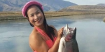 Nantiya uses her muscles to lift her big rainbow trout.