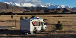 The RV in Twizel with the first snow on the high tops.