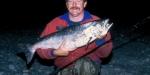 Allan Burgess with a silver sea-run salmon from the Hurunui River mouth lagoon.