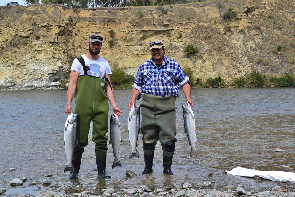 Nik Christidis and Charles Smith with limit bags from the Hurunui River mouth 22 March 2017.