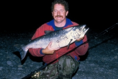 Allan Burgess with a silver sea-run salmon from the Hurunui River mouth lagoon.