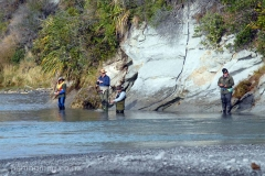 Salmon anglers fishing the lower Hurunui River from the landward side of the Hurunui River, February 2017.