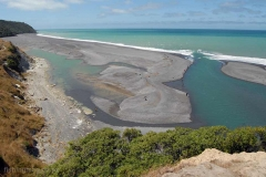 View looking north-east from the cliffs above the Hurunui River mouth, February 2017. The shape of the lagoon and position of the river mouth are constantly changing as a consequence of wave action, tide, and river flow volumes. Sometimes the river can exit the lagoon at the far end near the hills at the top left of this picture. When it does anglers have a long walk to get to the mouth proper.