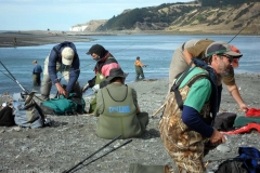 Salmon anglers gathered on a shingle bar near the north side of the Hurunui River mouth, February 2017.