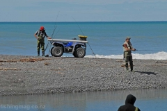 A quad bike on the shingle spit on the south side of the Hurunui River mouth. February 2017. The rider has travelled down the spit from the Blythe River Valley.