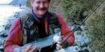 Allan Burgess with a landlocked salmon taken spin fishing at the Picket Fence, Lake Coleridge, 1996.