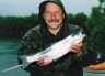 Allan Burgess with a salmon ona wet Lake Coleridge Opening Weekend.