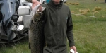 A big brown trout about to be weighed by Fish and Game at Ryton Bay for the lake Coleridge Opening Competition.