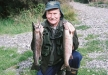 Allan Burgess with a brace of rainbows from Lake Selfe.