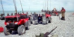 Salmon anglers' quad bikes on the beach at South Rakaia.