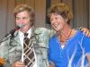 "Compare ""Ken"" Linda Topp - of the Topp Twins - congratulates Jill Burrows winner of the major prize draw."