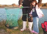 An eel makes a super catch for this young angler at Macintoshes Rocks. Waimakariri River.