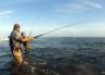 Neil Bond into a kahawai at the Waimakariri River mouth. It is just too much fun! Waimakariri River Trout and Salmon Fishing - fishingmag.co.nz