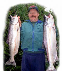 Allan Burgess with a brace of salmon from the Waimakariri River.