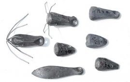 A variety of heavy surfcasting sinkers made by cutting and shaping a heavy Puka Bomb (shown bottom left).