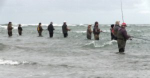 Fishing for kahawai at the mouth of Canterbury's Waimakariri River.