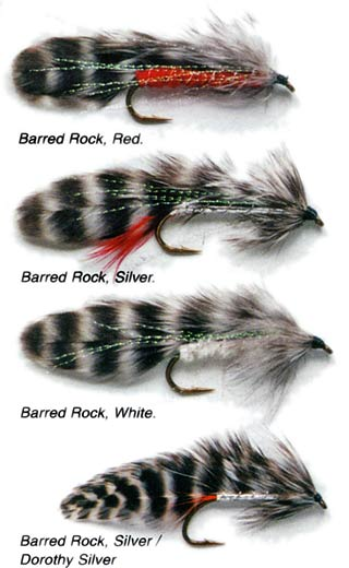 Barred Rock feathered lure or streamer fly variants. From the top: Barred Rock, Red. Barred Rock, Silver. Barred Rock, White. Barred Rock, Silver/Silver Dorothy. These are all excellent patterns for sea-run brown trout and kahawai.
