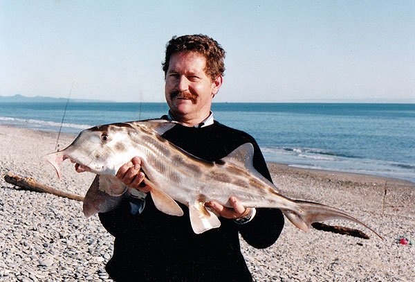 Allan Burges with an elephantfish caught surfcasting near Haast, Westland.