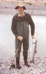 The author with a salmon on a two-handed fly rod.
