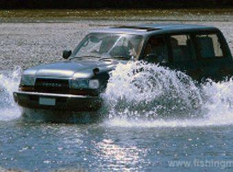 Crossing shallow water by Toyota 4×4 in the lower Waimakariri River. Fish hooks