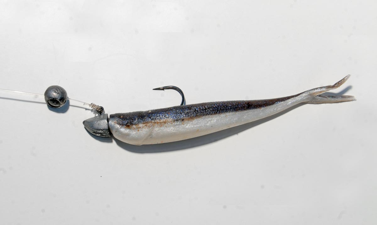 If you don't have a jig-head that is heavy enough try clipping on a split-shot. It works quite well for getting your lure a bit deeper.