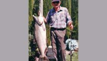 Norm Thackwell with what would be one of the heaviest salmon ever landed in New Zealand. Featured image.