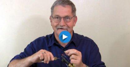 Allan tying a yellow rabbit lure.