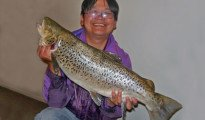 Mark Ho with a big sea-run brown trout from the Selwyn River.