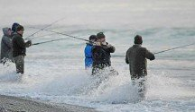 Surf fishing the Rakaia River mouth at first light for kahawai and sea-run brown trout.