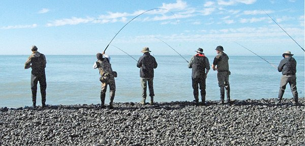 Fishing the surf at the mouth of the Rakaia River.