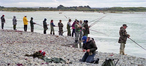 Casting for salmon near the Waitaki River mouth.