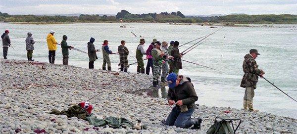 Casting for salmon near the Waitaki River mouth.