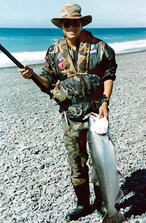 Keith Chin with a fat silver chinook salmon from the surf at the mouth of North Canterbury's Hurunui River.