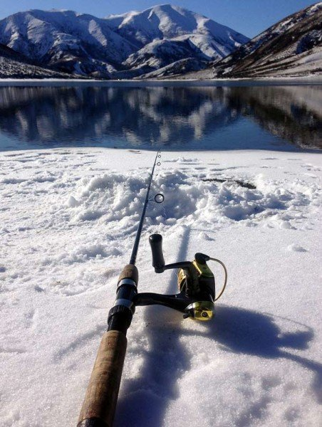 After casting you can place your rod on the snow with your reel drag backed-off while you jump up and down to warm up!