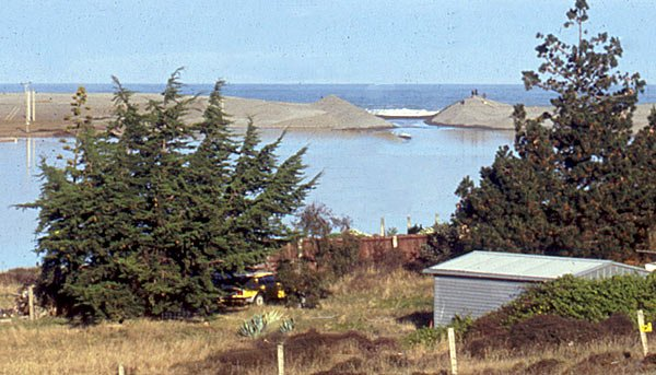 View of the cutting to allow the level of Lake Forsyth to drain into the sea. Picture taken from the baches at Birdlings Flat after three bulldozers had done their job. The cutting only remains open for a few days depending on sea conditions. During this time fresh searun trout enter the lake.