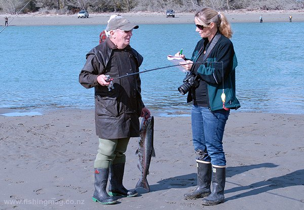 Colin Griffiths of Shirley with one of the ten salmon caught during the competition talks to North Canterbury Fish & Game's Emily Moore.