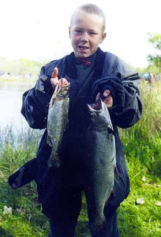 Fish for dinner tonight! A proud young angler displays his catch for the camera. Fish and Game do a magnificent job stocking these small lakes. Many who get their first taste of fishing here will go on to become life-long anglers.