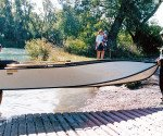 "Two anglers can carry the 12' 6"" Porta Bote Genesis III down to the water's edge."