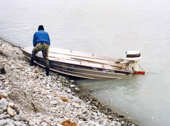 This salmon angler has crossed the Rangitata River in his outboard jet boat to fish the beach on the south side of the lagoon.